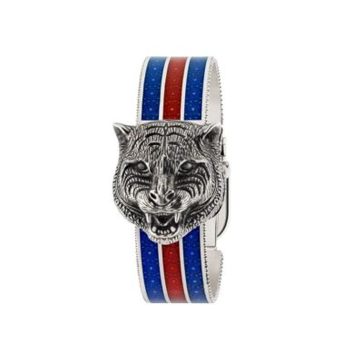 146 md / carved antique silver rotating feline head / white mother of pearl dial / carved silver bangle / blue-red-blue web enamel