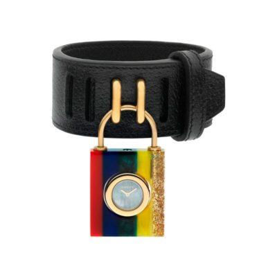 150 sm /rainbow plexiglas case / white mother of pearl dial / black leather strap